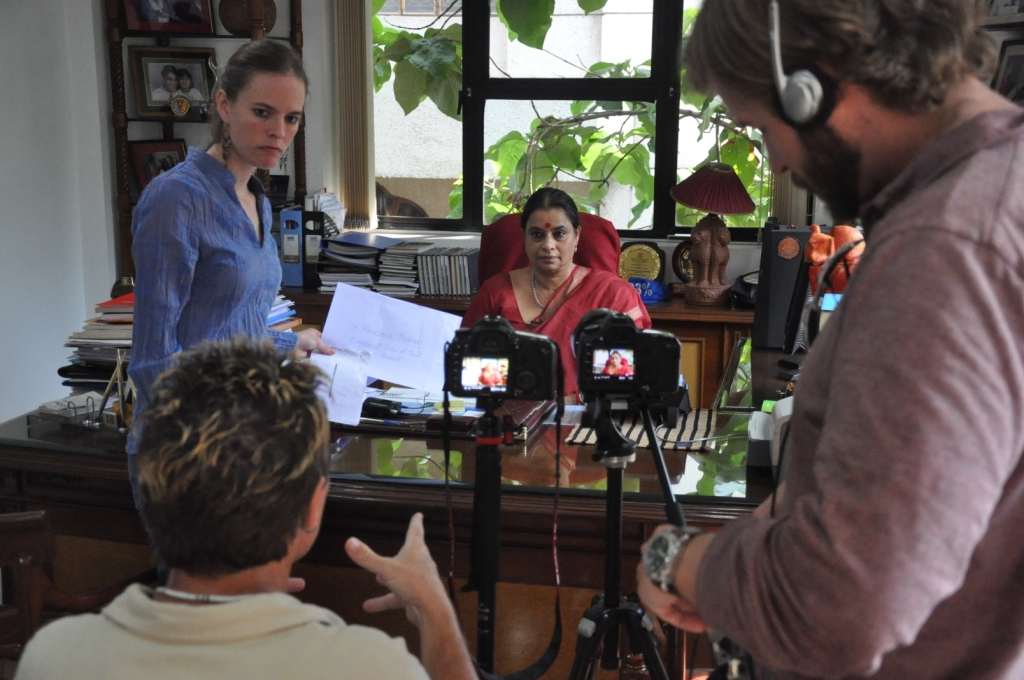 Evan Grae Davis and his team interviewing a women's rights campaigner in India.